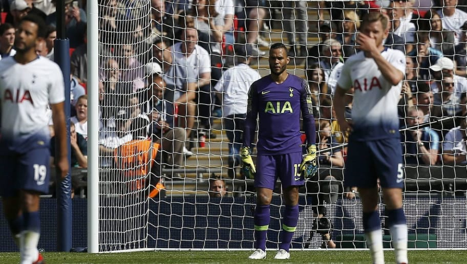 Tottenham Hotspur's Dutch goalkeeper Michel Vorm reacts after Liverpool scored their second goal during the English Premier League football match between Tottenham Hotspur and Liverpool at Wembley Stadium in London, on September 15, 2018. (Photo by Ian KINGTON / IKIMAGES / AFP) / RESTRICTED TO EDITORIAL USE. No use with unauthorized audio, video, data, fixture lists, club/league logos or 'live' services. Online in-match use limited to 45 images, no video emulation. No use in betting, games or single club/league/player publications.        (Photo credit should read IAN KINGTON/AFP/Getty Images)