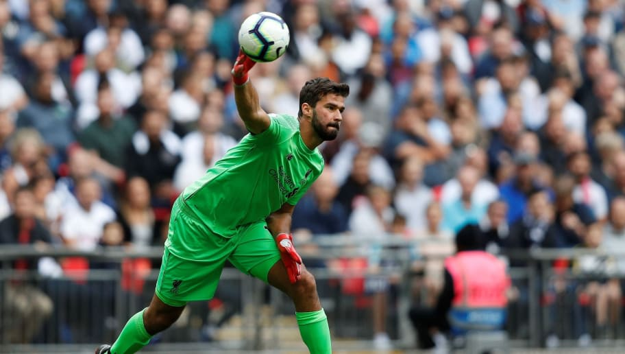 Liverpool's Brazilian goalkeeper Alisson Becker throws the ball during the English Premier League football match between Tottenham Hotspur and Liverpool at Wembley Stadium in London, on September 15, 2018. (Photo by Adrian DENNIS / AFP) / RESTRICTED TO EDITORIAL USE. No use with unauthorized audio, video, data, fixture lists, club/league logos or 'live' services. Online in-match use limited to 120 images. An additional 40 images may be used in extra time. No video emulation. Social media in-match use limited to 120 images. An additional 40 images may be used in extra time. No use in betting publications, games or single club/league/player publications. /         (Photo credit should read ADRIAN DENNIS/AFP/Getty Images)