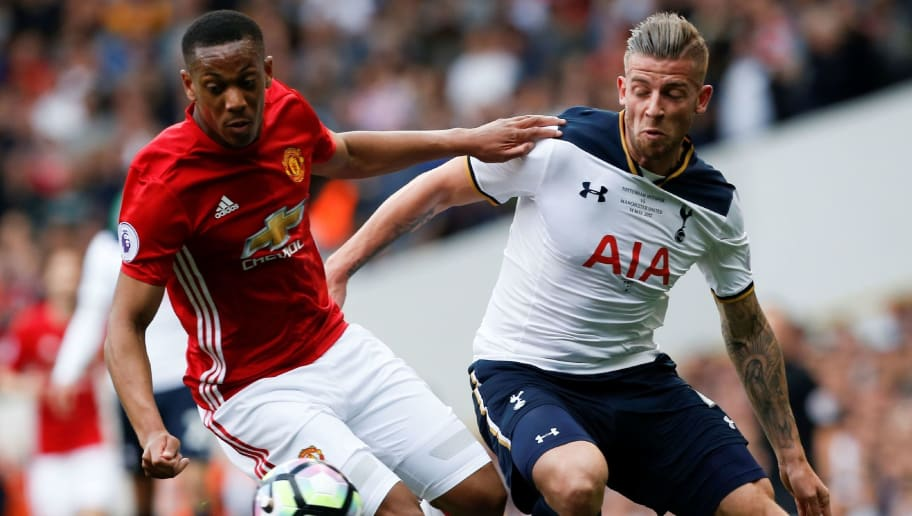 Manchester United's French striker Anthony Martial (L) vies with Tottenham Hotspur's Belgian defender Toby Alderweireld during the English Premier League football match between Tottenham Hotspur and Manchester United at White Hart Lane in London, on May 14, 2017. / AFP PHOTO / IKIMAGES / Ian KINGTON / RESTRICTED TO EDITORIAL USE. No use with unauthorized audio, video, data, fixture lists, club/league logos or 'live' services. Online in-match use limited to 45 images, no video emulation. No use in betting, games or single club/league/player publications.        (Photo credit should read IAN KINGTON/AFP/Getty Images)