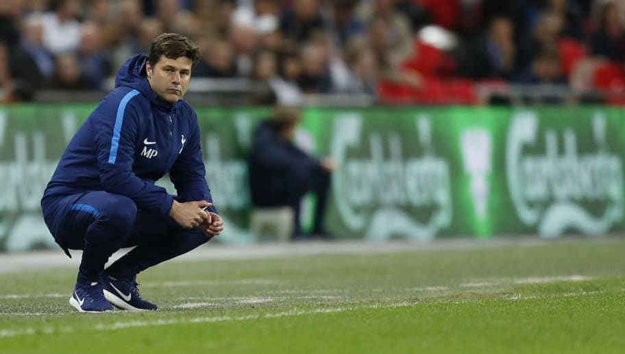 Tottenham Hotspur's Argentinian head coach Mauricio Pochettino looks on during the English Premier League football match between Tottenham Hotspur and Newcastle United at Wembley Stadium in London, on May 9, 2018. (Photo by Ian KINGTON / AFP) / RESTRICTED TO EDITORIAL USE. No use with unauthorized audio, video, data, fixture lists, club/league logos or 'live' services. Online in-match use limited to 75 images, no video emulation. No use in betting, games or single club/league/player publications. /         (Photo credit should read IAN KINGTON/AFP/Getty Images)