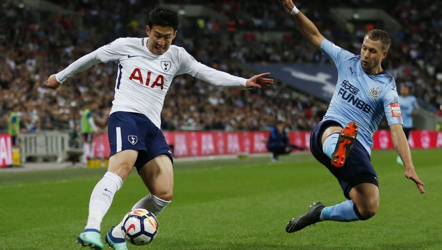 Tottenham Hotspur's South Korean striker Son Heung-Min (L) crosses the ball by Newcastle United's French midfielder Florian Lejeune during the English Premier League football match between Tottenham Hotspur and Newcastle United at Wembley Stadium in London, on May 9, 2018. (Photo by Ian KINGTON / AFP) / RESTRICTED TO EDITORIAL USE. No use with unauthorized audio, video, data, fixture lists, club/league logos or 'live' services. Online in-match use limited to 75 images, no video emulation. No use in betting, games or single club/league/player publications. /         (Photo credit should read IAN KINGTON/AFP/Getty Images)