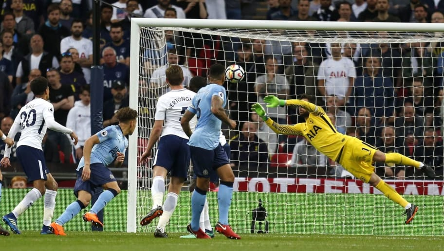 Newcastle United's English defender Jamaal Lascelles (2L) has a header saved by Tottenham Hotspur's French goalkeeper Hugo Lloris (R) during the English Premier League football match between Tottenham Hotspur and Newcastle United at Wembley Stadium in London, on May 9, 2018. (Photo by Ian KINGTON / AFP) / RESTRICTED TO EDITORIAL USE. No use with unauthorized audio, video, data, fixture lists, club/league logos or 'live' services. Online in-match use limited to 75 images, no video emulation. No use in betting, games or single club/league/player publications. /         (Photo credit should read IAN KINGTON/AFP/Getty Images)