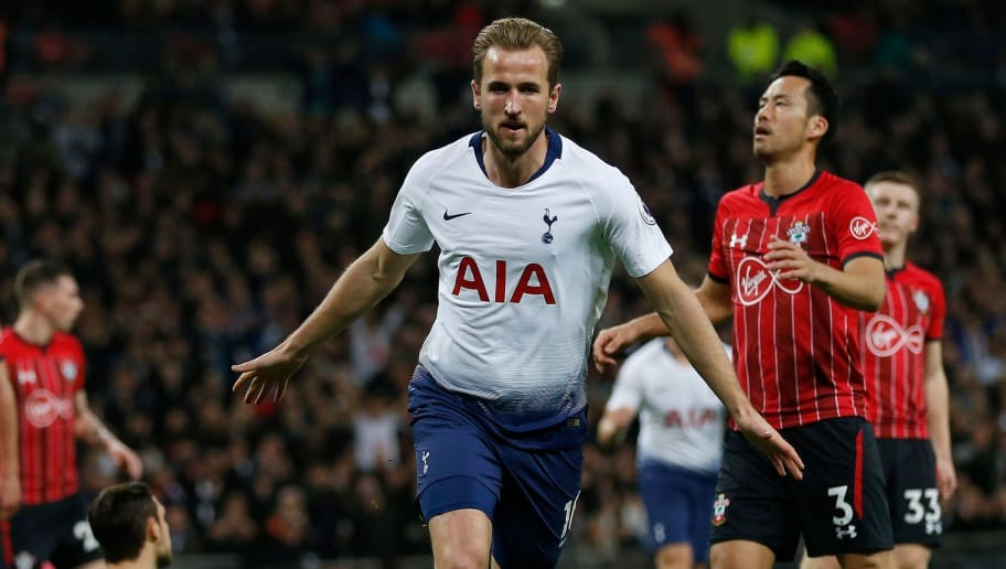 Tottenham Hotspur's English striker Harry Kane (C) celebrates scoring the opening goal during the English Premier League football match between Tottenham Hotspur and Southampton at Wembley Stadium in London, on December 5, 2018. (Photo by Ian KINGTON / AFP) / RESTRICTED TO EDITORIAL USE. No use with unauthorized audio, video, data, fixture lists, club/league logos or 'live' services. Online in-match use limited to 120 images. An additional 40 images may be used in extra time. No video emulation. Social media in-match use limited to 120 images. An additional 40 images may be used in extra time. No use in betting publications, games or single club/league/player publications. /         (Photo credit should read IAN KINGTON/AFP/Getty Images)
