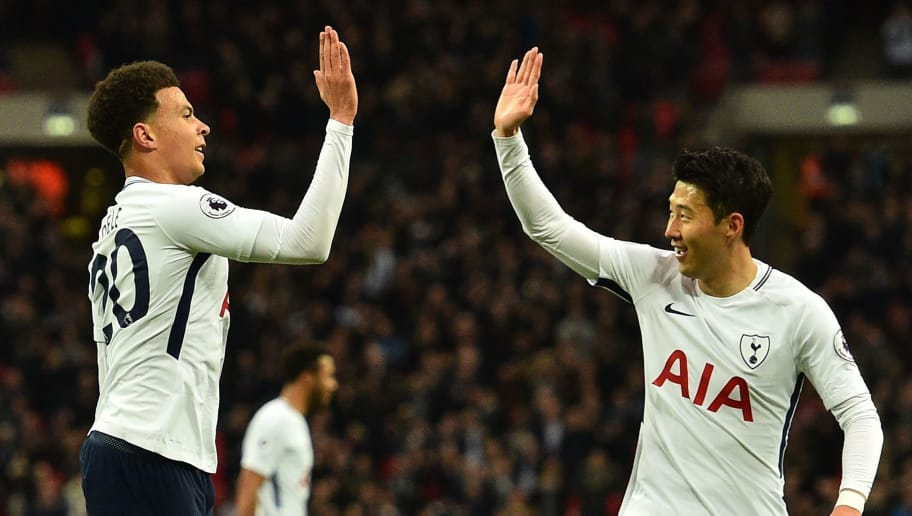 Tottenham Hotspur's English midfielder Dele Alli (L) celebrates scoring the opening goal with Tottenham Hotspur's South Korean striker Son Heung-Min during the English Premier League football match between Tottenham Hotspur and Watford at Wembley Stadium in London, on April 30, 2018. (Photo by Glyn KIRK / AFP) / RESTRICTED TO EDITORIAL USE. No use with unauthorized audio, video, data, fixture lists, club/league logos or 'live' services. Online in-match use limited to 75 images, no video emulation. No use in betting, games or single club/league/player publications. /         (Photo credit should read GLYN KIRK/AFP/Getty Images)