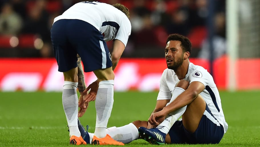 Tottenham Hotspur's Belgian midfielder Mousa Dembele (R) sustains an injury during the English Premier League football match between Tottenham Hotspur and Watford at Wembley Stadium in London, on April 30, 2018. (Photo by Glyn KIRK / AFP) / RESTRICTED TO EDITORIAL USE. No use with unauthorized audio, video, data, fixture lists, club/league logos or 'live' services. Online in-match use limited to 75 images, no video emulation. No use in betting, games or single club/league/player publications. /         (Photo credit should read GLYN KIRK/AFP/Getty Images)