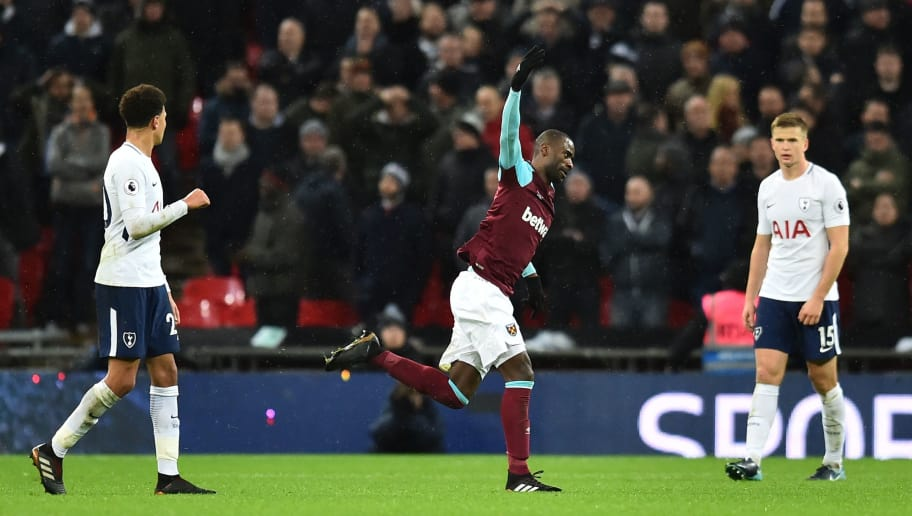 West Ham United's Spanish midfielder Pedro Obiang (C) celebrates scoring the opening goal during the English Premier League football match between Tottenham Hotspur and West Ham United at Wembley Stadium in London, on January 4, 2018. / AFP PHOTO / Glyn KIRK / RESTRICTED TO EDITORIAL USE. No use with unauthorized audio, video, data, fixture lists, club/league logos or 'live' services. Online in-match use limited to 75 images, no video emulation. No use in betting, games or single club/league/player publications.  /         (Photo credit should read GLYN KIRK/AFP/Getty Images)