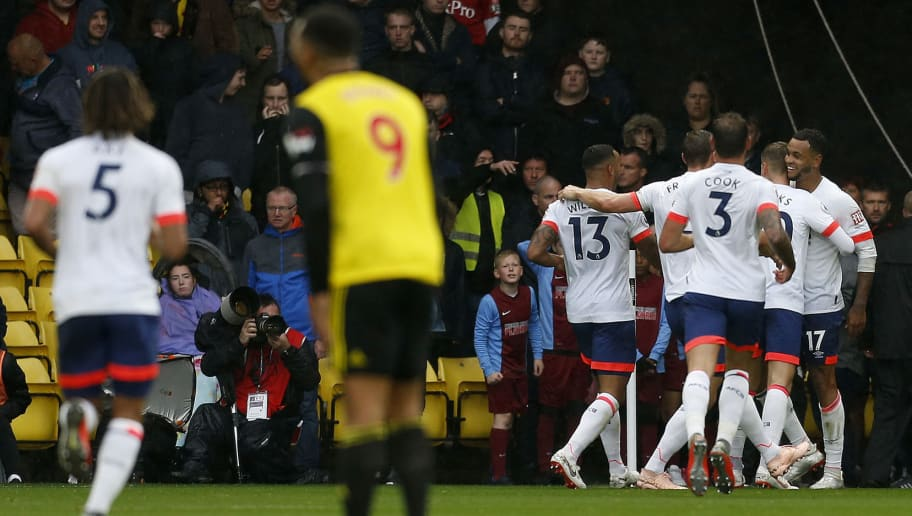 Bournemouth's Norwegian striker Joshua King (R) celebrates scoring his team's third, and his second, goal during the English Premier League football match between Watford and Bournemouth at Vicarage Road Stadium in Watford, north of London on October 6, 2018. (Photo by Ian KINGTON / AFP) / RESTRICTED TO EDITORIAL USE. No use with unauthorized audio, video, data, fixture lists, club/league logos or 'live' services. Online in-match use limited to 120 images. An additional 40 images may be used in extra time. No video emulation. Social media in-match use limited to 120 images. An additional 40 images may be used in extra time. No use in betting publications, games or single club/league/player publications. /         (Photo credit should read IAN KINGTON/AFP/Getty Images)