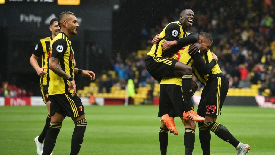 Watford's German-born Greek midfielder Jose Holebas (2R) celebrates with teammates after scoring the team's second goal during the English Premier League football match between Watford and Crystal Palace at Vicarage Road Stadium in Watford, north of London on August 26, 2018. (Photo by Glyn KIRK / AFP) / RESTRICTED TO EDITORIAL USE. No use with unauthorized audio, video, data, fixture lists, club/league logos or 'live' services. Online in-match use limited to 120 images. An additional 40 images may be used in extra time. No video emulation. Social media in-match use limited to 120 images. An additional 40 images may be used in extra time. No use in betting publications, games or single club/league/player publications. /         (Photo credit should read GLYN KIRK/AFP/Getty Images)