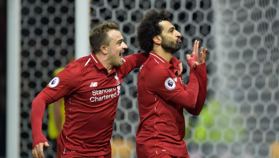 Liverpool's Egyptian midfielder Mohamed Salah (R) celebrates with Liverpool's Swiss midfielder Xherdan Shaqiri after scoring the opening goal of the English Premier League football match between Watford and Liverpool at Vicarage Road Stadium in Watford, north of London on November 24, 2018. (Photo by OLLY GREENWOOD / AFP) / RESTRICTED TO EDITORIAL USE. No use with unauthorized audio, video, data, fixture lists, club/league logos or 'live' services. Online in-match use limited to 120 images. An additional 40 images may be used in extra time. No video emulation. Social media in-match use limited to 120 images. An additional 40 images may be used in extra time. No use in betting publications, games or single club/league/player publications. /         (Photo credit should read OLLY GREENWOOD/AFP/Getty Images)