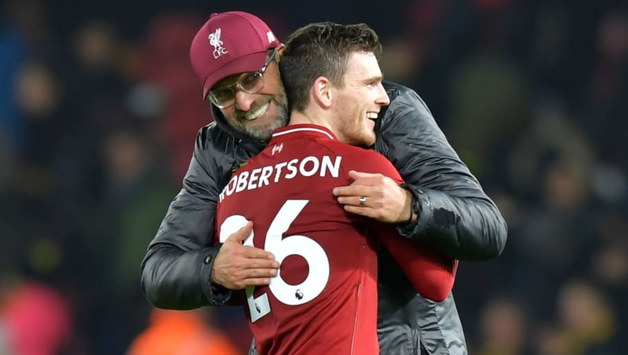Liverpool's German manager Jurgen Klopp celebrates with Liverpool's Scottish defender Andrew Robertson on the pitch after the English Premier League football match between Watford and Liverpool at Vicarage Road Stadium in Watford, north of London on November 24, 2018. - Liverpool won the game 3-0. (Photo by OLLY GREENWOOD / AFP) / RESTRICTED TO EDITORIAL USE. No use with unauthorized audio, video, data, fixture lists, club/league logos or 'live' services. Online in-match use limited to 120 images. An additional 40 images may be used in extra time. No video emulation. Social media in-match use limited to 120 images. An additional 40 images may be used in extra time. No use in betting publications, games or single club/league/player publications. /         (Photo credit should read OLLY GREENWOOD/AFP/Getty Images)