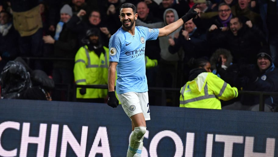 Manchester City's Algerian midfielder Riyad Mahrez celebrates scoring his team's second goal during the English Premier League football match between Watford and Manchester City at Vicarage Road Stadium in Watford, north of London on December 4, 2018. (Photo by Ben STANSALL / AFP) / RESTRICTED TO EDITORIAL USE. No use with unauthorized audio, video, data, fixture lists, club/league logos or 'live' services. Online in-match use limited to 120 images. An additional 40 images may be used in extra time. No video emulation. Social media in-match use limited to 120 images. An additional 40 images may be used in extra time. No use in betting publications, games or single club/league/player publications. /         (Photo credit should read BEN STANSALL/AFP/Getty Images)