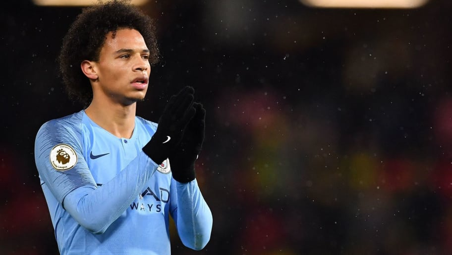 Manchester City's German midfielder Leroy Sane  celebrates following the English Premier League football match between Watford and Manchester City at Vicarage Road Stadium in Watford, north of London on December 4, 2018. (Photo by Ben STANSALL / AFP) / RESTRICTED TO EDITORIAL USE. No use with unauthorized audio, video, data, fixture lists, club/league logos or 'live' services. Online in-match use limited to 120 images. An additional 40 images may be used in extra time. No video emulation. Social media in-match use limited to 120 images. An additional 40 images may be used in extra time. No use in betting publications, games or single club/league/player publications. /         (Photo credit should read BEN STANSALL/AFP/Getty Images)