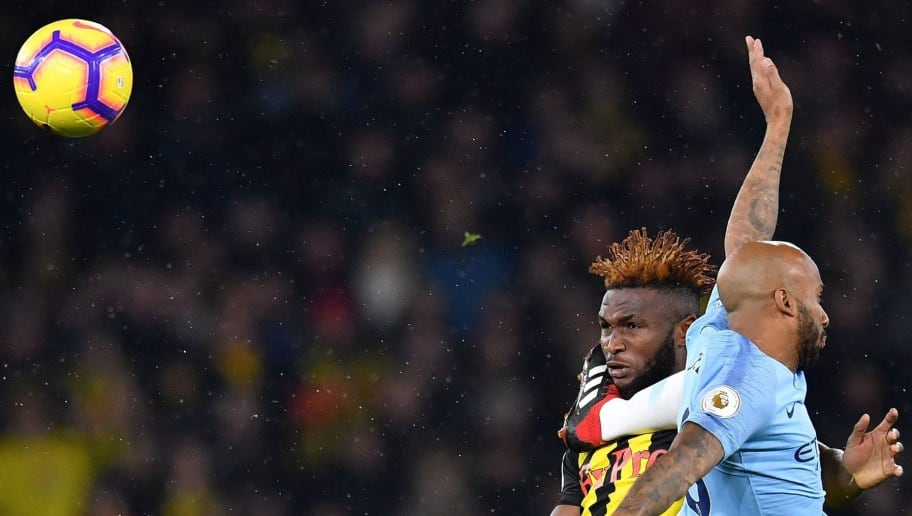 Watford's Nigerian striker Isaac Success (L) vies with Manchester City's English midfielder Fabian Delph during the English Premier League football match between Watford and Manchester City at Vicarage Road Stadium in Watford, north of London on December 4, 2018. (Photo by Ben STANSALL / AFP) / RESTRICTED TO EDITORIAL USE. No use with unauthorized audio, video, data, fixture lists, club/league logos or 'live' services. Online in-match use limited to 120 images. An additional 40 images may be used in extra time. No video emulation. Social media in-match use limited to 120 images. An additional 40 images may be used in extra time. No use in betting publications, games or single club/league/player publications. /         (Photo credit should read BEN STANSALL/AFP/Getty Images)
