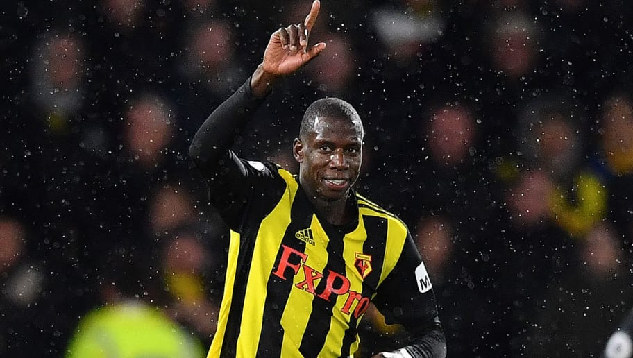 Watford's French midfielder Abdoulaye Doucoure celebrates scoring his team's first goal during the English Premier League football match between Watford and Manchester City at Vicarage Road Stadium in Watford, north of London on December 4, 2018. (Photo by Ben STANSALL / AFP) / RESTRICTED TO EDITORIAL USE. No use with unauthorized audio, video, data, fixture lists, club/league logos or 'live' services. Online in-match use limited to 120 images. An additional 40 images may be used in extra time. No video emulation. Social media in-match use limited to 120 images. An additional 40 images may be used in extra time. No use in betting publications, games or single club/league/player publications. / (Photo credit should read BEN STANSALL/AFP/Getty Images)