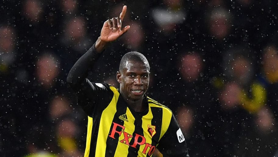 Watford's French midfielder Abdoulaye Doucoure (C) celebrates scoring his team's first goal during the English Premier League football match between Watford and Manchester City at Vicarage Road Stadium in Watford, north of London on December 4, 2018. (Photo by Ben STANSALL / AFP) / RESTRICTED TO EDITORIAL USE. No use with unauthorized audio, video, data, fixture lists, club/league logos or 'live' services. Online in-match use limited to 120 images. An additional 40 images may be used in extra time. No video emulation. Social media in-match use limited to 120 images. An additional 40 images may be used in extra time. No use in betting publications, games or single club/league/player publications. /         (Photo credit should read BEN STANSALL/AFP/Getty Images)