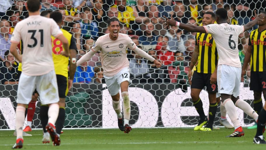 Manchester United's English defender Chris Smalling celebrates after scoring their second goal during the English Premier League football match between Watford and Manchester United at Vicarage Road Stadium in Watford, north of London on September 15, 2018. (Photo by OLLY GREENWOOD / AFP) / RESTRICTED TO EDITORIAL USE. No use with unauthorized audio, video, data, fixture lists, club/league logos or 'live' services. Online in-match use limited to 120 images. An additional 40 images may be used in extra time. No video emulation. Social media in-match use limited to 120 images. An additional 40 images may be used in extra time. No use in betting publications, games or single club/league/player publications. /         (Photo credit should read OLLY GREENWOOD/AFP/Getty Images)