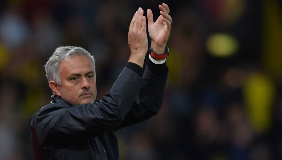 Manchester United's Portuguese manager Jose Mourinho applauds fans after winning the English Premier League football match between Watford and Manchester United at Vicarage Road Stadium in Watford, north of London on September 15, 2018. (Photo by OLLY GREENWOOD / AFP) / RESTRICTED TO EDITORIAL USE. No use with unauthorized audio, video, data, fixture lists, club/league logos or 'live' services. Online in-match use limited to 120 images. An additional 40 images may be used in extra time. No video emulation. Social media in-match use limited to 120 images. An additional 40 images may be used in extra time. No use in betting publications, games or single club/league/player publications. /         (Photo credit should read OLLY GREENWOOD/AFP/Getty Images)