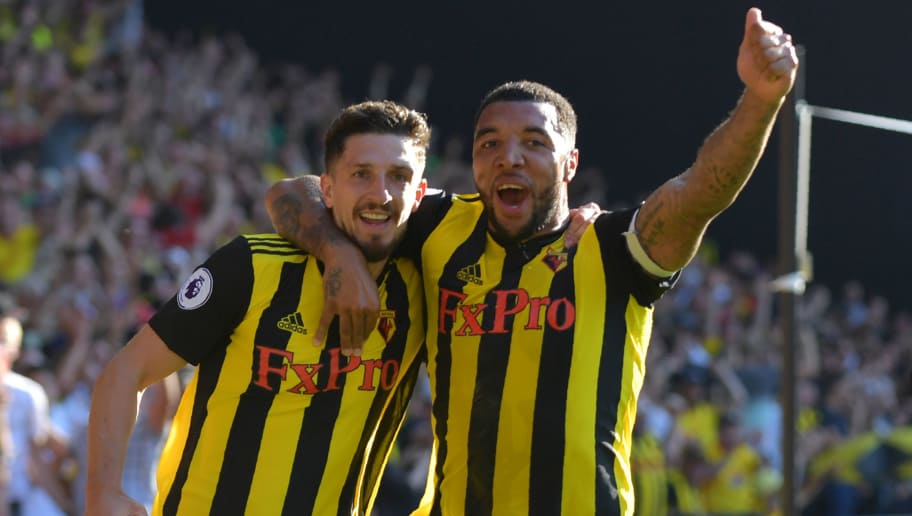Watford's Northern Irish defender Craig Cathcart (L) celebrates with Watford's English striker Troy Deeney after scoring their second goal during the English Premier League football match between Watford and Tottenham Hotspur at Vicarage Road Stadium in Watford, north of London on September 2, 2018. (Photo by OLLY GREENWOOD / AFP) / RESTRICTED TO EDITORIAL USE. No use with unauthorized audio, video, data, fixture lists, club/league logos or 'live' services. Online in-match use limited to 120 images. An additional 40 images may be used in extra time. No video emulation. Social media in-match use limited to 120 images. An additional 40 images may be used in extra time. No use in betting publications, games or single club/league/player publications. /         (Photo credit should read OLLY GREENWOOD/AFP/Getty Images)