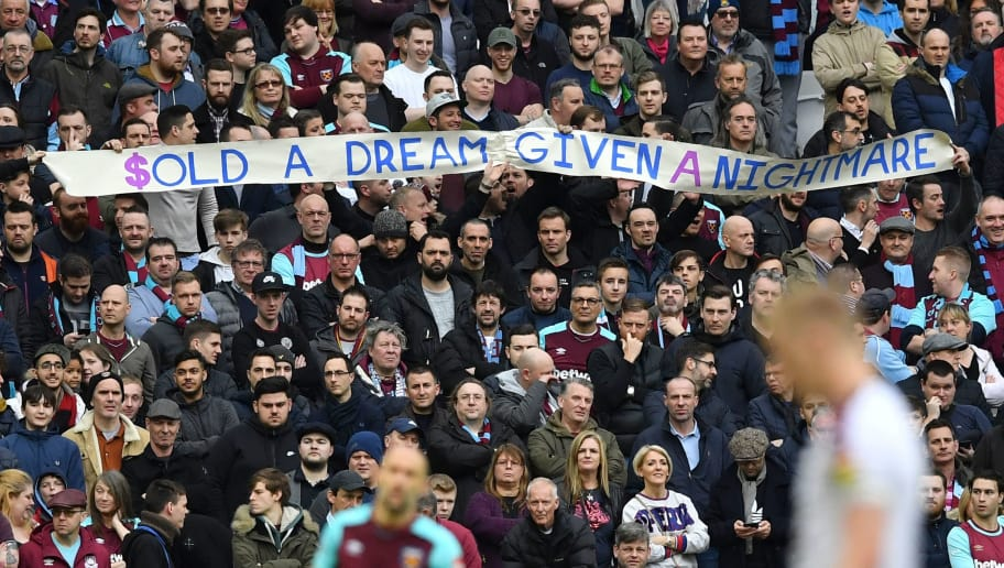 West Ham fans hold up a banner during the English Premier League football  match between West e35ef88d0