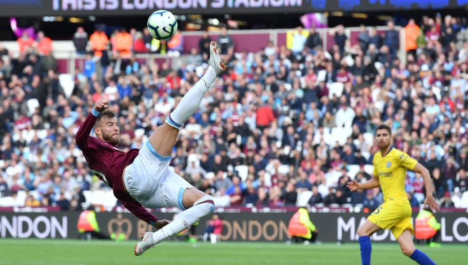 West Ham United's Ukrainian striker Andriy Yarmolenko clears the ball during the English Premier League football match between West Ham United and Chelsea at The London Stadium, in east London on September 23, 2018. - The game finished 0-0. (Photo by Ben STANSALL / AFP) / RESTRICTED TO EDITORIAL USE. No use with unauthorized audio, video, data, fixture lists, club/league logos or 'live' services. Online in-match use limited to 120 images. An additional 40 images may be used in extra time. No video emulation. Social media in-match use limited to 120 images. An additional 40 images may be used in extra time. No use in betting publications, games or single club/league/player publications. /         (Photo credit should read BEN STANSALL/AFP/Getty Images)