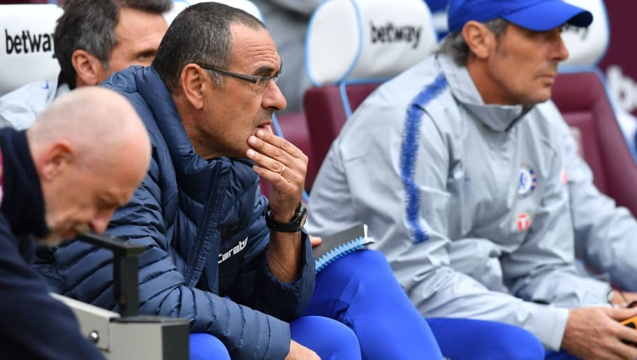 Chelsea's Italian head coach Maurizio Sarri awaits kick off in the English Premier League football match between West Ham United and Chelsea at The London Stadium, in east London on September 23, 2018. (Photo by Ben STANSALL / AFP) / RESTRICTED TO EDITORIAL USE. No use with unauthorized audio, video, data, fixture lists, club/league logos or 'live' services. Online in-match use limited to 120 images. An additional 40 images may be used in extra time. No video emulation. Social media in-match use limited to 120 images. An additional 40 images may be used in extra time. No use in betting publications, games or single club/league/player publications. /         (Photo credit should read BEN STANSALL/AFP/Getty Images)