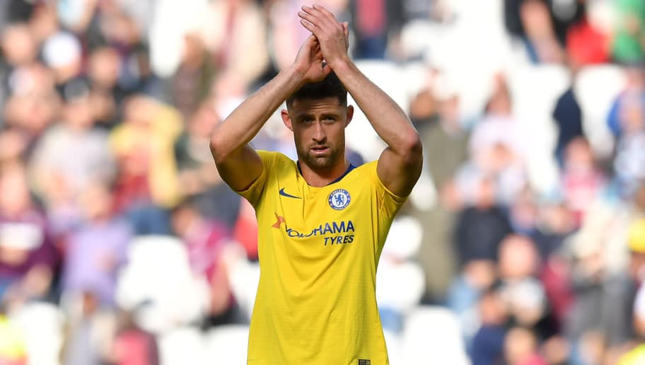 Chelsea's English defender Gary Cahill applauds supporters after the English Premier League football match between West Ham United and Chelsea at The London Stadium, in east London on September 23, 2018. - The game finished 0-0. (Photo by Ben STANSALL / AFP) / RESTRICTED TO EDITORIAL USE. No use with unauthorized audio, video, data, fixture lists, club/league logos or 'live' services. Online in-match use limited to 120 images. An additional 40 images may be used in extra time. No video emulation. Social media in-match use limited to 120 images. An additional 40 images may be used in extra time. No use in betting publications, games or single club/league/player publications. /         (Photo credit should read BEN STANSALL/AFP/Getty Images)