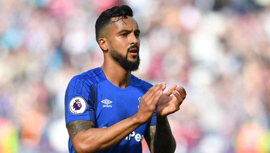 Everton's English striker Theo Walcott applauds supporters on the pitch after the English Premier League football match between West Ham United and Everton at The London Stadium, in east London on May 13, 2018. - West Ham won the game 3-1. (Photo by Ben STANSALL / AFP) / RESTRICTED TO EDITORIAL USE. No use with unauthorized audio, video, data, fixture lists, club/league logos or 'live' services. Online in-match use limited to 75 images, no video emulation. No use in betting, games or single club/league/player publications. /         (Photo credit should read BEN STANSALL/AFP/Getty Images)