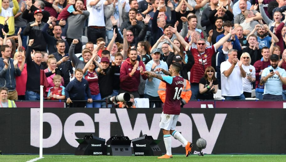 West Ham United's Argentinian midfielder Manuel Lanzini celebrates with supporters after scoring their third goal during the English Premier League football match between West Ham United and Everton at The London Stadium, in east London on May 13, 2018. - West Ham won the game 3-1. (Photo by Ben STANSALL / AFP) / RESTRICTED TO EDITORIAL USE. No use with unauthorized audio, video, data, fixture lists, club/league logos or 'live' services. Online in-match use limited to 75 images, no video emulation. No use in betting, games or single club/league/player publications. /         (Photo credit should read BEN STANSALL/AFP/Getty Images)