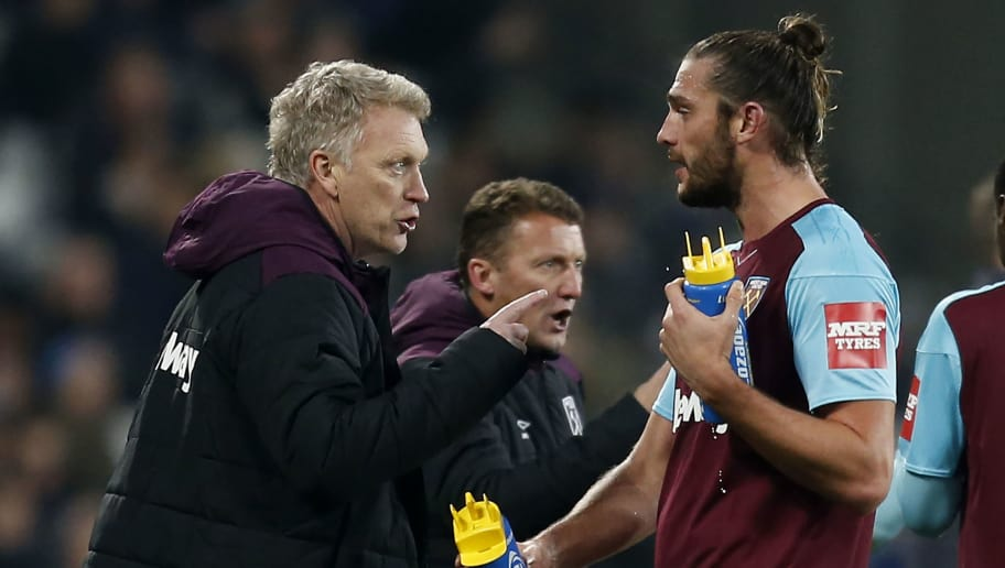 West Ham United's Scottish manager David Moyes (L) talks to West Ham United's English striker Andy Carroll during the English Premier League football match between West Ham United and Leicester City at The London Stadium, in east London on November 24, 2017. / AFP PHOTO / Ian KINGTON / RESTRICTED TO EDITORIAL USE. No use with unauthorized audio, video, data, fixture lists, club/league logos or 'live' services. Online in-match use limited to 75 images, no video emulation. No use in betting, games or single club/league/player publications.  /         (Photo credit should read IAN KINGTON/AFP/Getty Images)