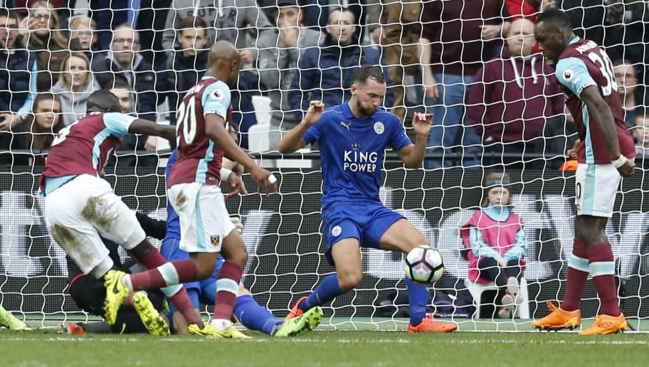 Leicester City's English midfielder Danny Drinkwater (C) blocks a shot on the goal line during the English Premier League football match between West Ham United and Leicester City at The London Stadium, in east London on March 18, 2017. / AFP PHOTO / Ian KINGTON / RESTRICTED TO EDITORIAL USE. No use with unauthorized audio, video, data, fixture lists, club/league logos or 'live' services. Online in-match use limited to 75 images, no video emulation. No use in betting, games or single club/league/player publications.  /         (Photo credit should read IAN KINGTON/AFP/Getty Images)