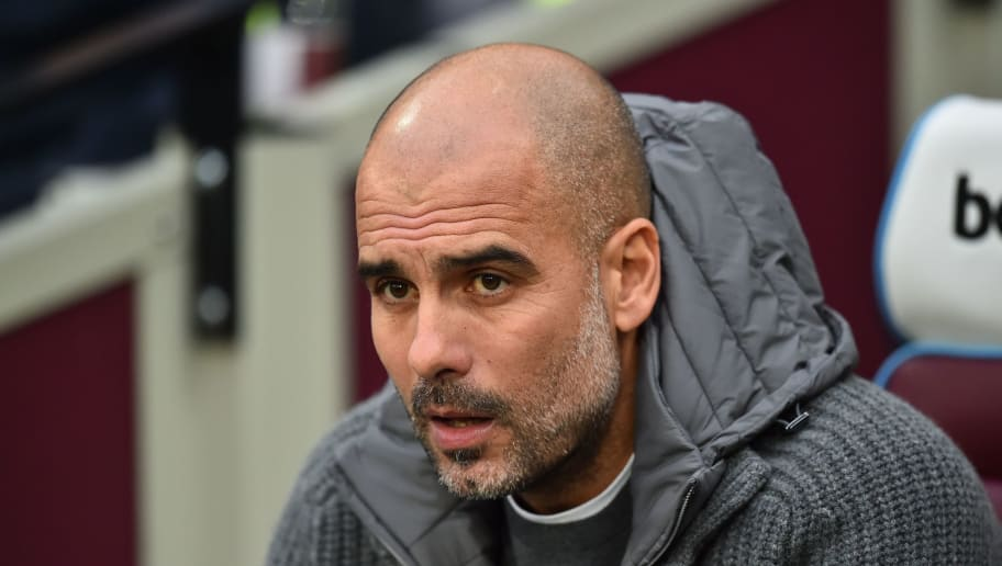 Manchester City's Spanish manager Pep Guardiola takes his seat for the English Premier League football match between West Ham United and Manchester City at The London Stadium, in east London on November 24, 2018. (Photo by Glyn KIRK / AFP) / RESTRICTED TO EDITORIAL USE. No use with unauthorized audio, video, data, fixture lists, club/league logos or 'live' services. Online in-match use limited to 120 images. An additional 40 images may be used in extra time. No video emulation. Social media in-match use limited to 120 images. An additional 40 images may be used in extra time. No use in betting publications, games or single club/league/player publications. /         (Photo credit should read GLYN KIRK/AFP/Getty Images)
