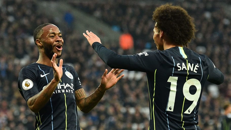 Manchester City's English midfielder Raheem Sterling (L) celebrates scoring their second goal with Manchester City's German midfielder Leroy Sane (R) during the English Premier League football match between West Ham United and Manchester City at The London Stadium, in east London on November 24, 2018. (Photo by Glyn KIRK / AFP) / RESTRICTED TO EDITORIAL USE. No use with unauthorized audio, video, data, fixture lists, club/league logos or 'live' services. Online in-match use limited to 120 images. An additional 40 images may be used in extra time. No video emulation. Social media in-match use limited to 120 images. An additional 40 images may be used in extra time. No use in betting publications, games or single club/league/player publications. /         (Photo credit should read GLYN KIRK/AFP/Getty Images)