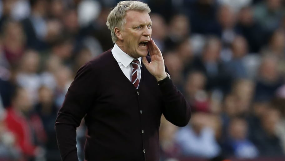 West Ham United's Scottish manager David Moyes shouts instructions to his players from the touchline during the English Premier League football match between West Ham United and Manchester United at The London Stadium, in east London on May 10, 2018. (Photo by Ian KINGTON / AFP) / RESTRICTED TO EDITORIAL USE. No use with unauthorized audio, video, data, fixture lists, club/league logos or 'live' services. Online in-match use limited to 75 images, no video emulation. No use in betting, games or single club/league/player publications. /         (Photo credit should read IAN KINGTON/AFP/Getty Images)