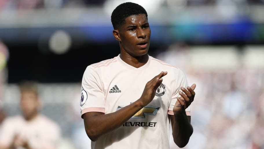 Manchester United's English striker Marcus Rashford applauds at the end of the English Premier League football match between West Ham United and Manchester United at The London Stadium, in east London on September 29, 2018. (Photo by Ian KINGTON / AFP) / RESTRICTED TO EDITORIAL USE. No use with unauthorized audio, video, data, fixture lists, club/league logos or 'live' services. Online in-match use limited to 120 images. An additional 40 images may be used in extra time. No video emulation. Social media in-match use limited to 120 images. An additional 40 images may be used in extra time. No use in betting publications, games or single club/league/player publications. /         (Photo credit should read IAN KINGTON/AFP/Getty Images)