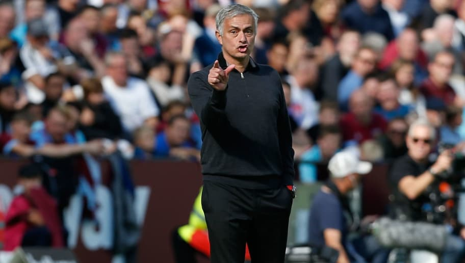 Manchester United's Portuguese manager Jose Mourinho gestures from the touchline during the English Premier League football match between West Ham United and Manchester United at The London Stadium, in east London on September 29, 2018. (Photo by Ian KINGTON / AFP) / RESTRICTED TO EDITORIAL USE. No use with unauthorized audio, video, data, fixture lists, club/league logos or 'live' services. Online in-match use limited to 120 images. An additional 40 images may be used in extra time. No video emulation. Social media in-match use limited to 120 images. An additional 40 images may be used in extra time. No use in betting publications, games or single club/league/player publications. /         (Photo credit should read IAN KINGTON/AFP/Getty Images)
