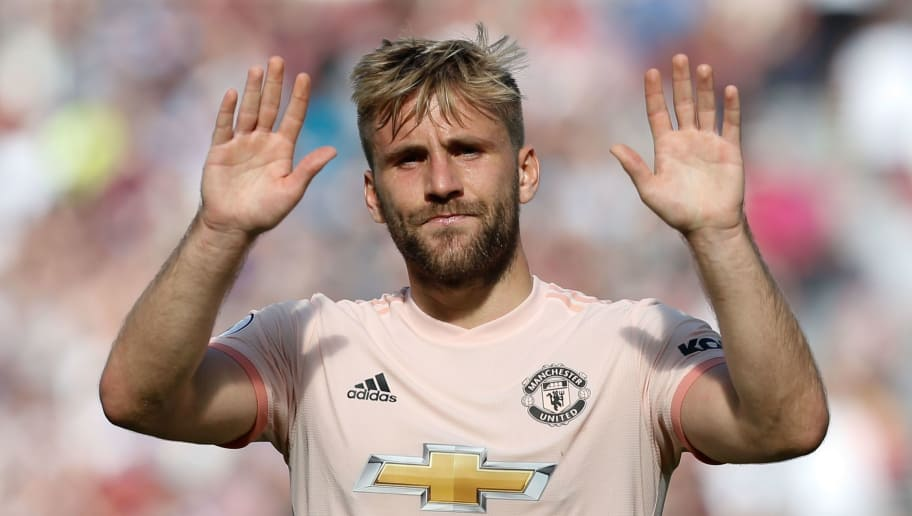 Manchester United's English defender Luke Shaw applauds at the end of the English Premier League football match between West Ham United and Manchester United at The London Stadium, in east London on September 29, 2018. (Photo by Ian KINGTON / AFP) / RESTRICTED TO EDITORIAL USE. No use with unauthorized audio, video, data, fixture lists, club/league logos or 'live' services. Online in-match use limited to 120 images. An additional 40 images may be used in extra time. No video emulation. Social media in-match use limited to 120 images. An additional 40 images may be used in extra time. No use in betting publications, games or single club/league/player publications. /         (Photo credit should read IAN KINGTON/AFP/Getty Images)