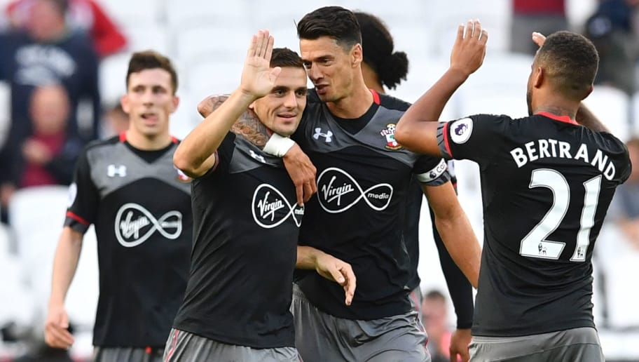 Southampton's Serbian midfielder Dusan Tadic (L), Southampton's Portuguese defender Jose Fonte (C) and Southampton's English defender Ryan Bertrand (R) celebrate together at the end of the English Premier League football match between West Ham United and Southampton at The London Stadium, in east London on September 25, 2016. / AFP / Ben STANSALL / RESTRICTED TO EDITORIAL USE. No use with unauthorized audio, video, data, fixture lists, club/league logos or 'live' services. Online in-match use limited to 75 images, no video emulation. No use in betting, games or single club/league/player publications.  /         (Photo credit should read BEN STANSALL/AFP/Getty Images)