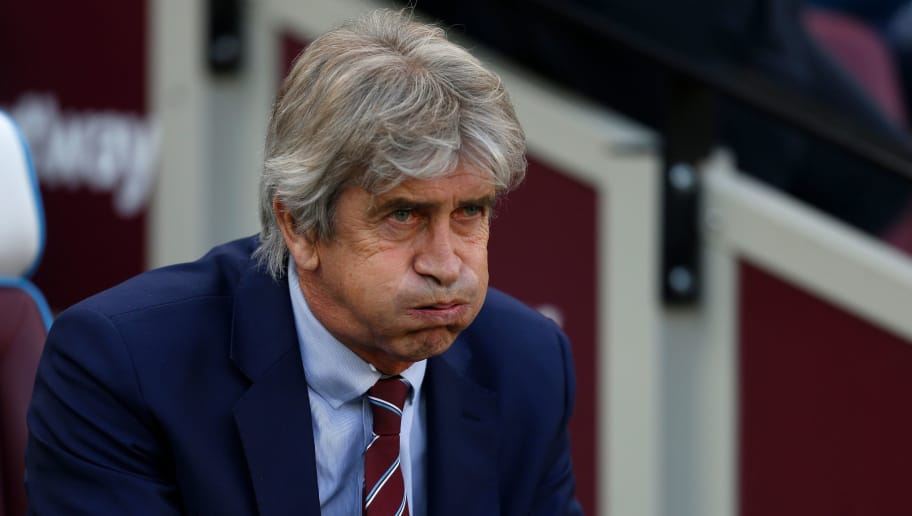 West Ham United's Chilean Manager Manuel Pellegrini awaits kick off during the English Premier League football match between West Ham United and Tottenham Hotspur at the London Stadium, in east London on October 20, 2018. (Photo by Ian KINGTON / AFP) / RESTRICTED TO EDITORIAL USE. No use with unauthorized audio, video, data, fixture lists, club/league logos or 'live' services. Online in-match use limited to 120 images. An additional 40 images may be used in extra time. No video emulation. Social media in-match use limited to 120 images. An additional 40 images may be used in extra time. No use in betting publications, games or single club/league/player publications.        (Photo credit should read IAN KINGTON/AFP/Getty Images)