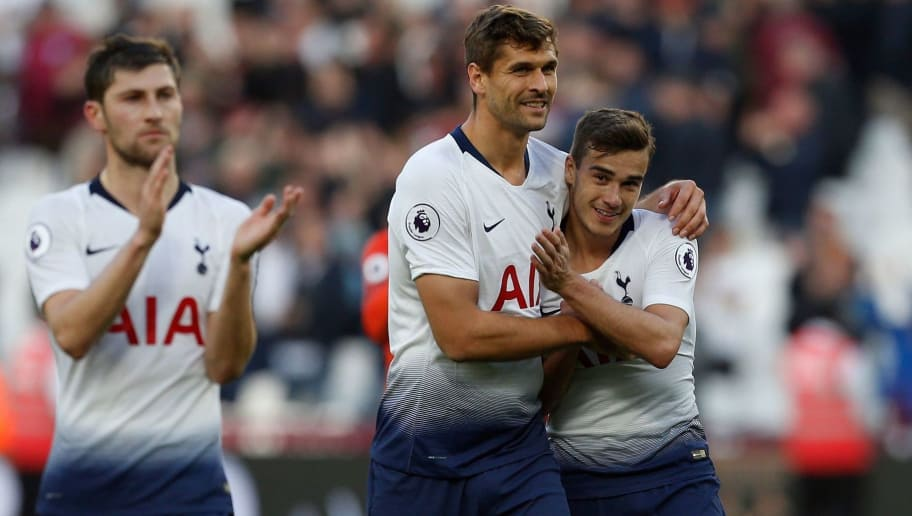 Tottenham Hotspur's Spanish forward Fernando Llorente (C) celebrates the win with Tottenham Hotspur's English midfielder Harry Winks (R) at the final whistle of the English Premier League football match between West Ham United and Tottenham Hotspur at the London Stadium, in east London on October 20, 2018. (Photo by Ian KINGTON / AFP) / RESTRICTED TO EDITORIAL USE. No use with unauthorized audio, video, data, fixture lists, club/league logos or 'live' services. Online in-match use limited to 120 images. An additional 40 images may be used in extra time. No video emulation. Social media in-match use limited to 120 images. An additional 40 images may be used in extra time. No use in betting publications, games or single club/league/player publications.        (Photo credit should read IAN KINGTON/AFP/Getty Images)