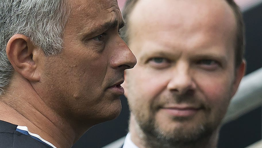 Manchester United's executive vice-chairman Ed Woodward (R) listens as Manchester United's Portuguese manager Jose Mourinho talks with former Manchester United player Bobby Charlton (not pictured) following the pre-season friendly football match between Wigan Athletic and Manchester United at the DW stadium in Wigan, northwest England, on July 16, 2016.  / AFP / JON SUPER / RESTRICTED TO EDITORIAL USE. No use with unauthorized audio, video, data, fixture lists, club/league logos or 'live' services. Online in-match use limited to 75 images, no video emulation. No use in betting, games or single club/league/player publications.  /         (Photo credit should read JON SUPER/AFP/Getty Images)