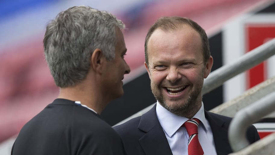 Manchester United's executive vice-chairman Ed Woodward (R) reacts as he talks with Manchester United's Portuguese manager Jose Mourinho folowing the pre-season friendly football match between Wigan Athletic and Manchester United at the DW stadium in Wigan, northwest England, on July 16, 2016.  / AFP / JON SUPER / RESTRICTED TO EDITORIAL USE. No use with unauthorized audio, video, data, fixture lists, club/league logos or 'live' services. Online in-match use limited to 75 images, no video emulation. No use in betting, games or single club/league/player publications.  /         (Photo credit should read JON SUPER/AFP/Getty Images)