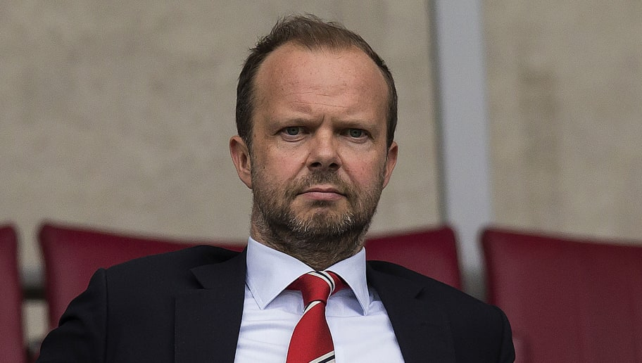 Manchester United's executive vice-chairman Ed Woodward watches from the stands ahead of the pre-season friendly football match between Wigan Athletic and Manchester United at the DW stadium in Wigan, northwest England, on July 16, 2016.  / AFP / JON SUPER / RESTRICTED TO EDITORIAL USE. No use with unauthorized audio, video, data, fixture lists, club/league logos or 'live' services. Online in-match use limited to 75 images, no video emulation. No use in betting, games or single club/league/player publications.  /         (Photo credit should read JON SUPER/AFP/Getty Images)