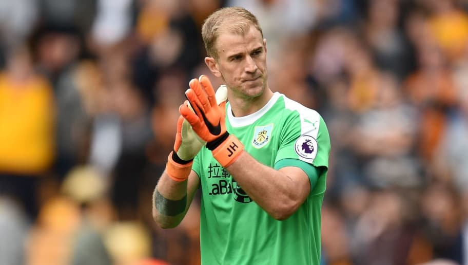 Burnley's English goalkeeper Joe Hart appluads supporters on the pitch after the English Premier League football match between Wolverhampton Wanderers and Burnley at the Molineux stadium in Wolverhampton, central England on September 16, 2018. - Wolves won the game 1-0. (Photo by Oli SCARFF / AFP) / RESTRICTED TO EDITORIAL USE. No use with unauthorized audio, video, data, fixture lists, club/league logos or 'live' services. Online in-match use limited to 120 images. An additional 40 images may be used in extra time. No video emulation. Social media in-match use limited to 120 images. An additional 40 images may be used in extra time. No use in betting publications, games or single club/league/player publications. /         (Photo credit should read OLI SCARFF/AFP/Getty Images)