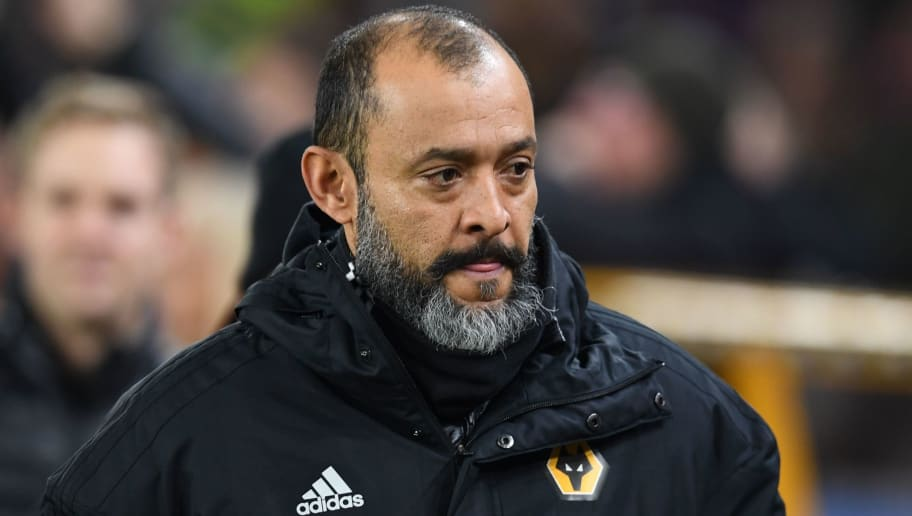 Wolverhampton Wanderers' Portuguese head coach Nuno Espirito Santo reacts ahead of the English Premier League football match between Wolverhampton Wanderers and Crystal Palace at the Molineux stadium in Wolverhampton, central England on January 2, 2019. (Photo by Paul ELLIS / AFP) / RESTRICTED TO EDITORIAL USE. No use with unauthorized audio, video, data, fixture lists, club/league logos or 'live' services. Online in-match use limited to 120 images. An additional 40 images may be used in extra time. No video emulation. Social media in-match use limited to 120 images. An additional 40 images may be used in extra time. No use in betting publications, games or single club/league/player publications. /         (Photo credit should read PAUL ELLIS/AFP/Getty Images)