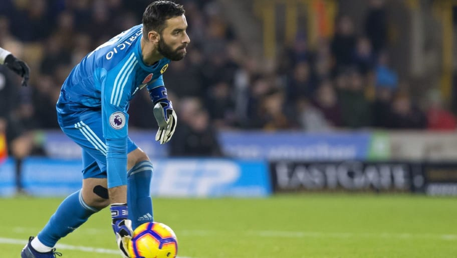 Wolverhampton Wanderers' Portuguese goalkeeper Rui Patricio rolls the ball out during the English Premier League football match between Wolverhampton Wanderers and Tottenham Hotspur at the Molineux stadium in Wolverhampton, central England  on November 3, 2018. (Photo by Roland HARRISON / AFP) / RESTRICTED TO EDITORIAL USE. No use with unauthorized audio, video, data, fixture lists, club/league logos or 'live' services. Online in-match use limited to 120 images. An additional 40 images may be used in extra time. No video emulation. Social media in-match use limited to 120 images. An additional 40 images may be used in extra time. No use in betting publications, games or single club/league/player publications. /         (Photo credit should read ROLAND HARRISON/AFP/Getty Images)