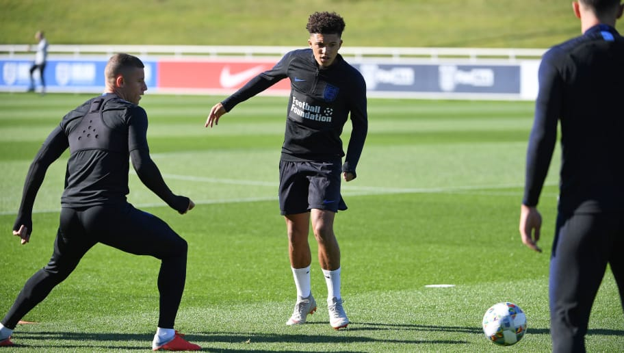 England's midfielder Jadon Sancho (C) and England's midfielder Ross Barkley (L) attend an open training session at St George's Park in Burton-on-Trent, central England on October 9, 2018 ahead of their UEFA Nations League match against Croatia on October 12. (Photo by Paul ELLIS / AFP) / NOT FOR MARKETING OR ADVERTISING USE / RESTRICTED TO EDITORIAL USE        (Photo credit should read PAUL ELLIS/AFP/Getty Images)