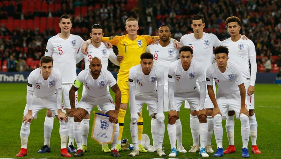 England's starting XI, (L-R back) England's defender Michael Keane, England's defender Ben Chilwell, England's goalkeeper Jordan Pickford, England's striker Callum Wilson, England's defender Lewis Dunk, England's midfielder Dele Alli (L-R bottom) England's midfielder Harry Winks, England's midfielder Fabian Delph, England's midfielder Jesse Lingard, England's defender Trent Alexander-Arnold and England's midfielder Jadon Sancho before kick off of the international friendly football match between England and the United States at Wembley stadium in north London on November 15, 2018. - Wayne Rooney is set to make his final farewell as England's greatest ever goalscorer in a friendly against the United States. (Photo by Ian KINGTON / AFP) / NOT FOR MARKETING OR ADVERTISING USE / RESTRICTED TO EDITORIAL USE        (Photo credit should read IAN KINGTON/AFP/Getty Images)
