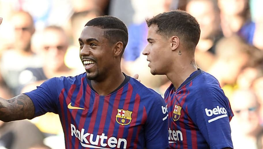 Barcelona's Brazilian midfielder Malcom (C) celebrates with Barcelona's Brazilian midfielder Philippe Coutinho (R) and Barcelona's Spanish defender Gerard Pique after scoring a goal during the 53rd Joan Gamper Trophy friendly football match between Barcelona and Boca Juniors at the Camp Nou stadium in Barcelona on August 15, 2018. (Photo by Josep LAGO / AFP)        (Photo credit should read JOSEP LAGO/AFP/Getty Images)