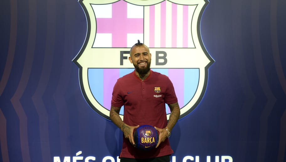 Former player of Bayern Munich football club, Arturo Vidal, poses at his new team's headquarters on August 5, 2018, one day after FC Barcelona announced an agreement with Bayern Munich to sign Chilean midfielder in a deal reportedly worth 30 million euros ($35 million). (Photo by Josep LAGO / AFP)        (Photo credit should read JOSEP LAGO/AFP/Getty Images)