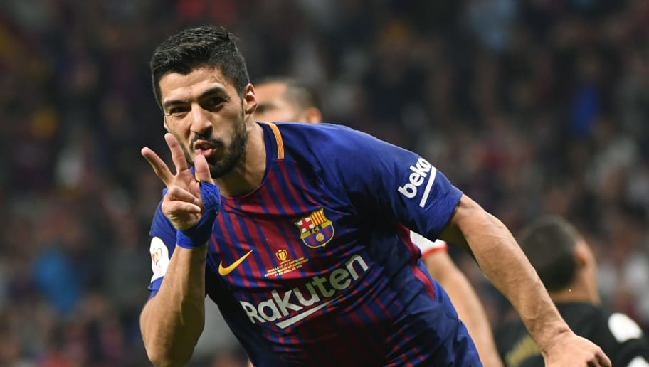 Barcelona's Uruguayan forward Luis Suarez celebrates after scoring his second goal during the Spanish Copa del Rey (King's Cup) final football match Sevilla FC against FC Barcelona at the Wanda Metropolitano stadium in Madrid on April 21, 2018. (Photo by PIERRE-PHILIPPE MARCOU / AFP)        (Photo credit should read PIERRE-PHILIPPE MARCOU/AFP/Getty Images)